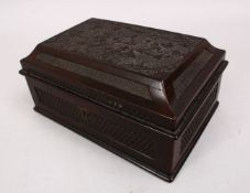 A GOOD 20TH CENTURY CHINESE CARVED WOODEN METAL LINED TEA CADDY, the box carved with native floral