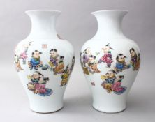 A PAIR OF CHINESE REPUBLIC PERIOD FAMILLE ROSE PORCELAIN VASES OF BOYS PLAYING, the body of the