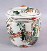 A CHINESE FAMILLE VERTE PORCELAIN JAR AND COVER, decorated with scenes of figures in a balcony