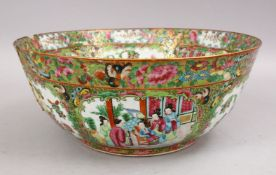 A LARGE 19TH CENTURY CHINESE CANTON FAMILLE ROSE PORCELAIN BOWL, with panel decoration of figures,