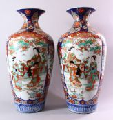 A LARGE PAIR OF JAPANESE MEIJI PERIOD IMARI PORCELAIN VASES, with panel decoration depicting figures
