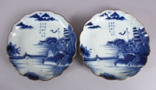 A PAIR OF JAPANESE MEIJI PERIOD BLUE & WHITE ARITA PORCELAIN DISHES, each decorated with native