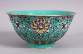 A CHINESE FAMMILE ROSE TURQUOISE GROUND LOTUS PORCELAIN BOWL, decorated with formal scrolling