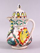 A 19TH CENTURY TURKISH KUTAHYA WATER JUG AND COVER, overall height 20cm.