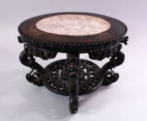 A GOOD CHINESE CARVED HARDWOOD STAND, with inlaid marble top, 22cm high, 30cm diameter.