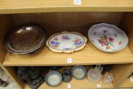 Two floral decorated dishes and a plated bowl.