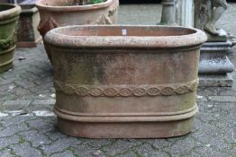 A good large oval terracotta planter with moulded decoration, stamped with a manufacturer's name.
