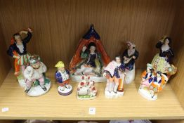 A group of Staffordshire figures.