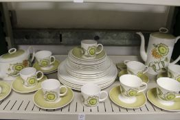 A quantity of Susie Cooper or Wedgwood Sunflower pattern china.