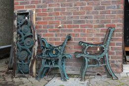Three pairs of cast metal bench ends together with a seat and a back from one bench.
