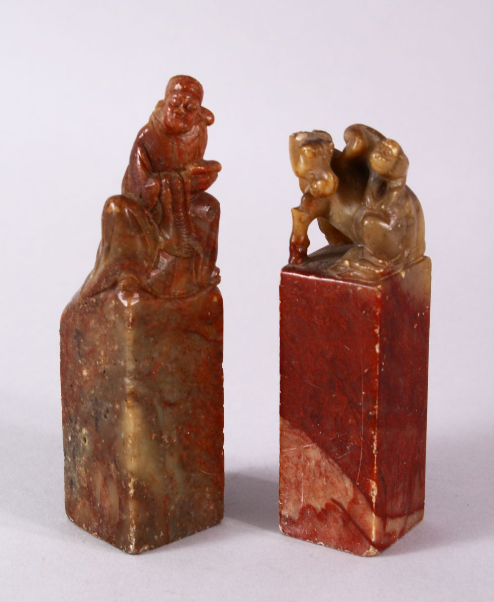 A PAIR OF 19TH / 20TH CENTURY CHINESE CARVED SOAPSTONE SEALS, one of monkeys upon horse, the other
