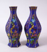 A 19TH / 20TH CENTURY CHINESE CLOISONNE VASES, with wirework depicting floral spray upon a blue