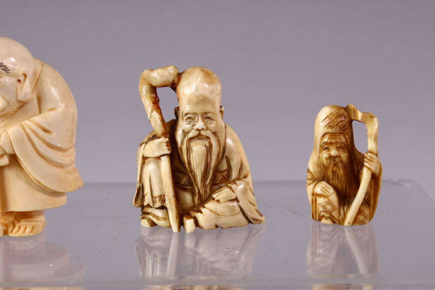 A LOT OF SIX JAPANESE MEIJI PERIOD CARVED IVORY NETSUKE, one of a seated and inlaid goddess, 6cm, - Image 4 of 8