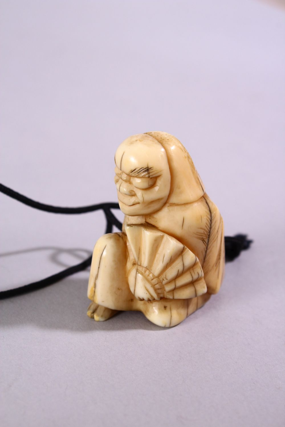 A JAPANESE MEIJI PERIOD CARVED IVORY THREE CASE INRO & NETSUKE, The inro carved with native - Image 2 of 7