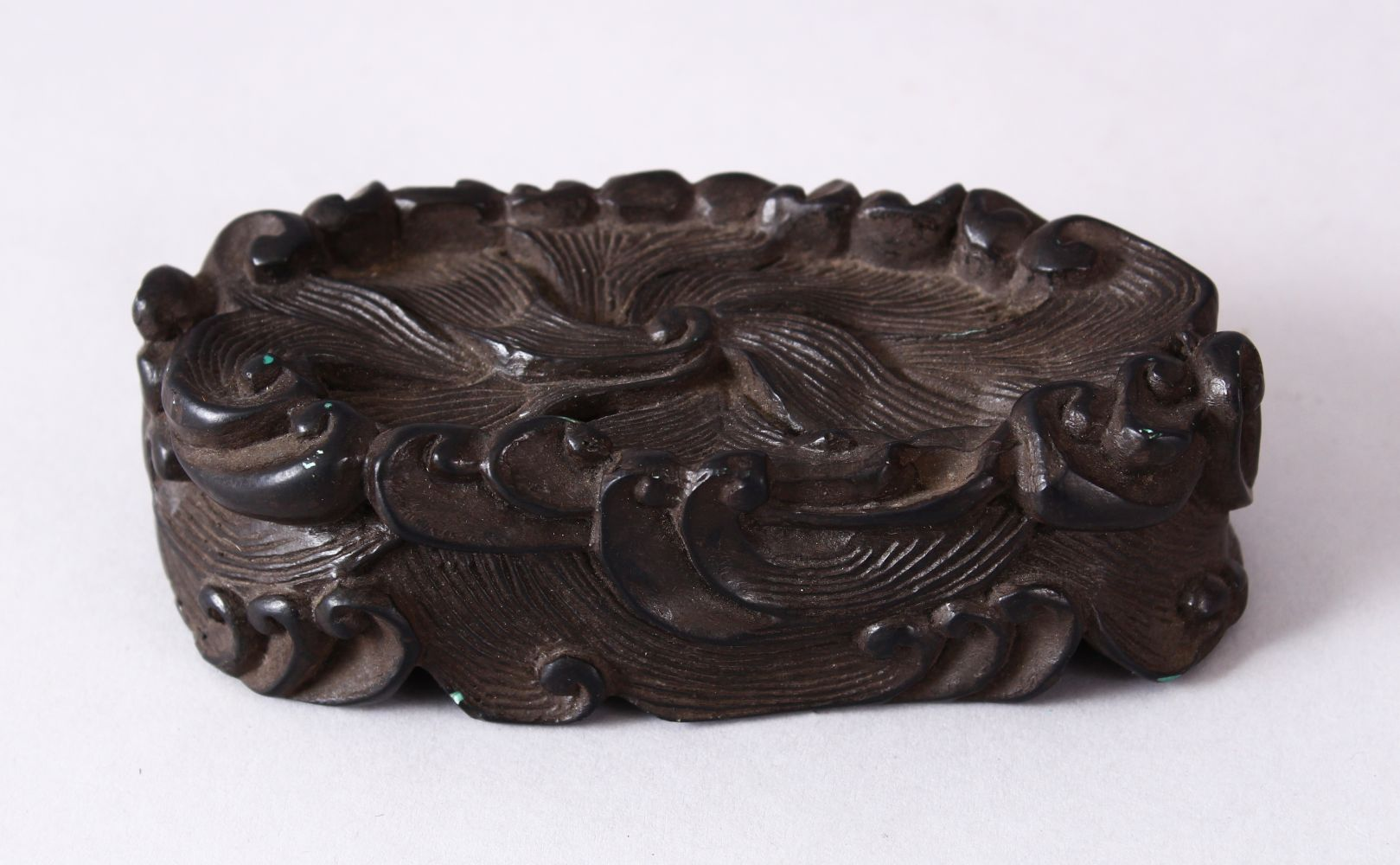 A CHINESE MOULDED WAVE STAND, in the form of crashing waves, 12cm wide x 5.5cm.