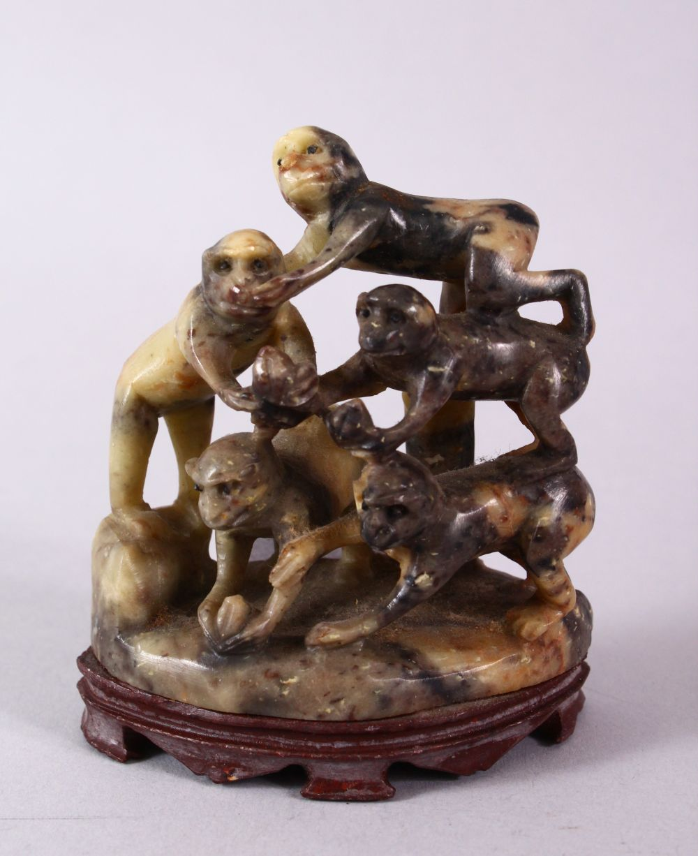 A 20TH CENTURY CHINESE CARVED SOAPSTONE MONKEY GROUP, carved with five monkeys climbing upon one and