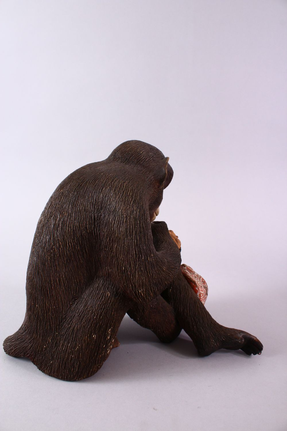 A JAPANESE POTTERY / TERRACOTTA MODEL OF A SEATED MONKEY, the monkey in a seated position holding - Image 5 of 10