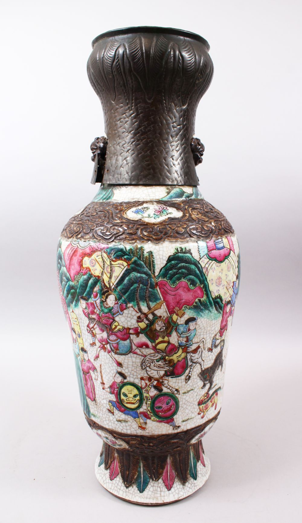 A 19TH CENTURY CHINESE FAMILLE ROSE CRACKLE GLAZED PORCELAIN VASE, painted with a battle scene,