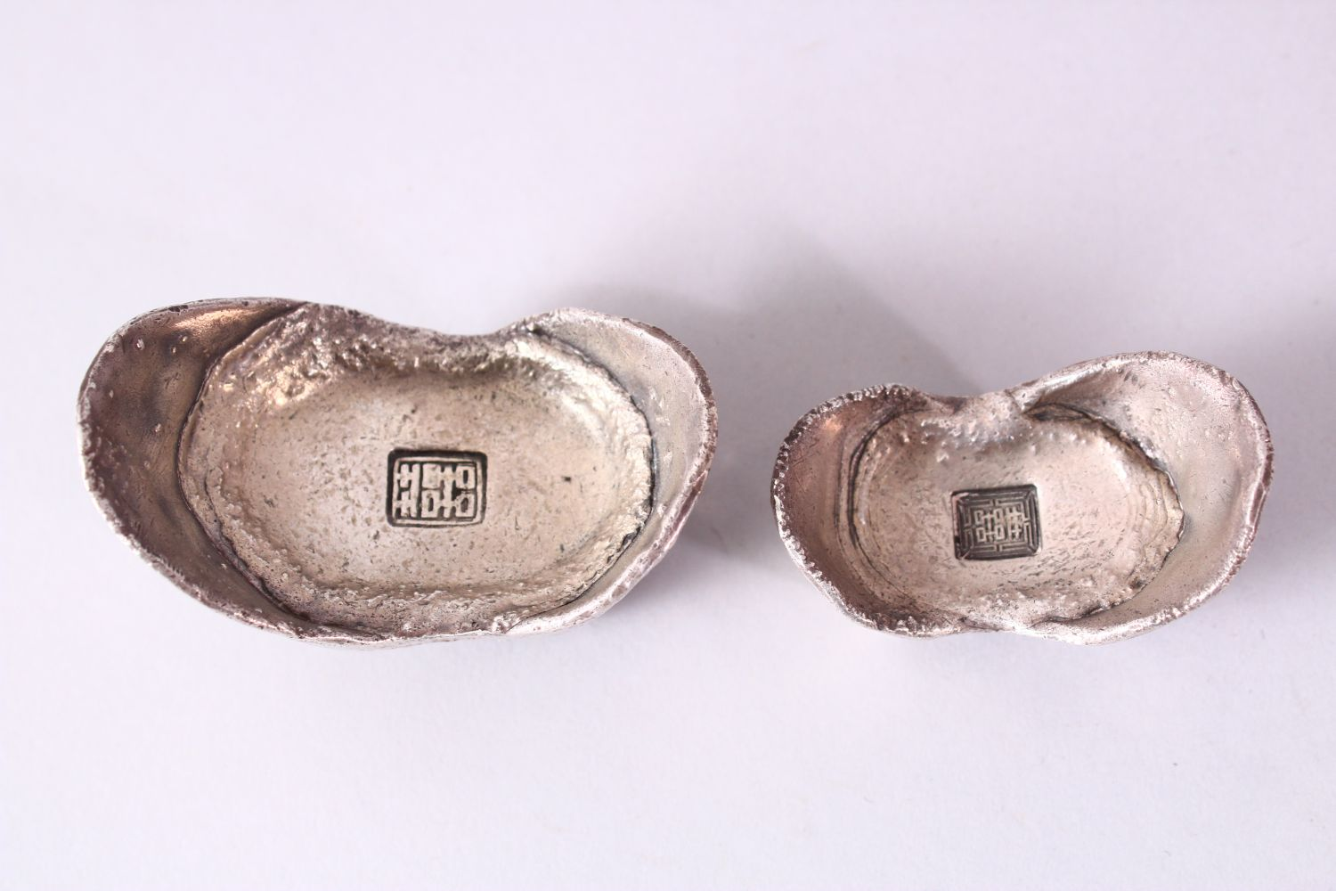 TWO PIECES OF CHINESE WHITE METAL POSSIBLY SILVER SHOE CURRENCY, 7cm and 6.5cm. - Image 2 of 3
