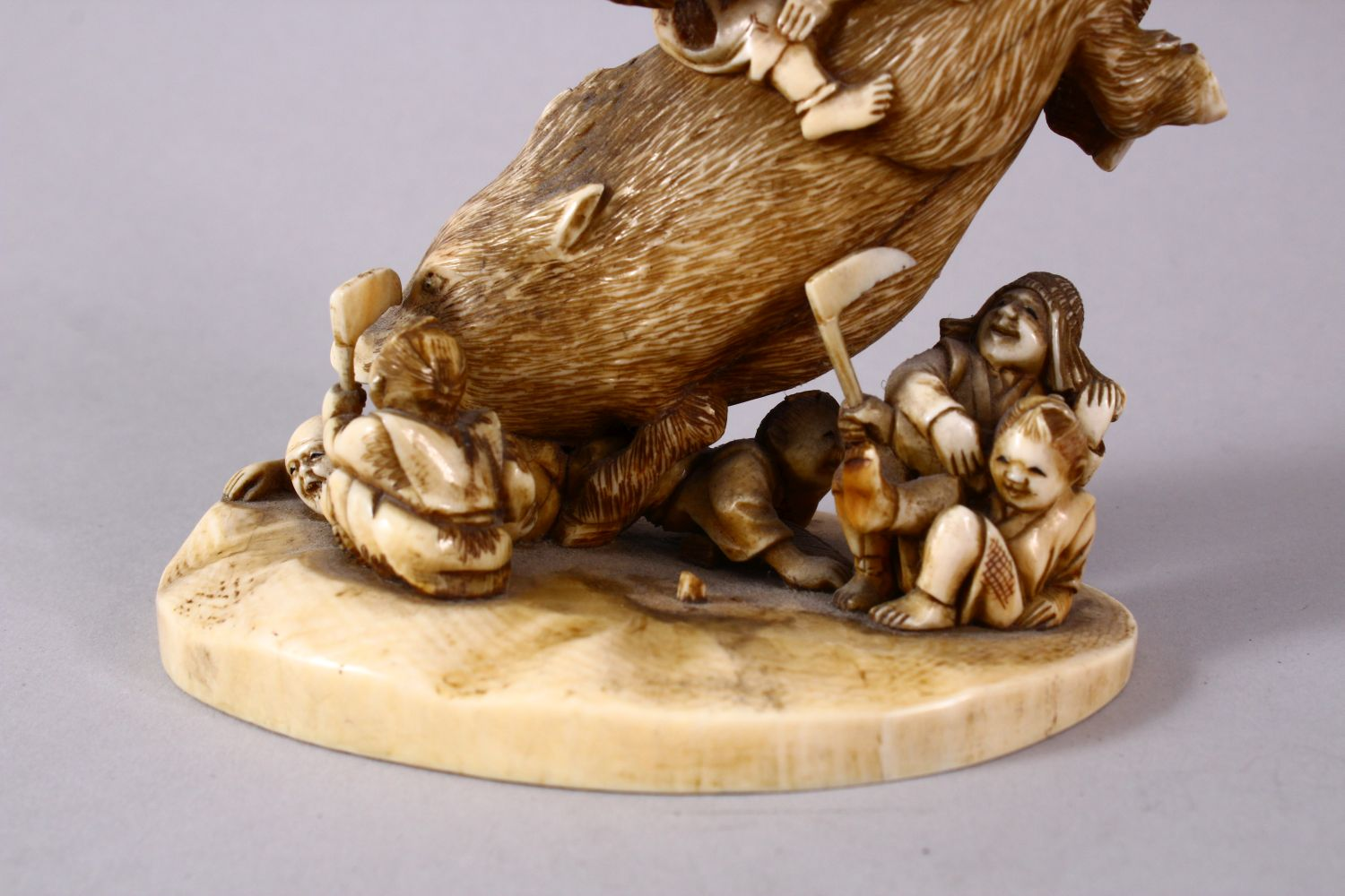 A JAPANESE MEIJI PERIOD CARVED IVORY OKIMONO GROUP- depicting a boar being attacked by numerous - Image 3 of 12