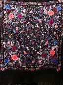 A 20TH CENTURY CHINESE EMBROIDERED BLACK SILK PIANO SHAWL / TEXTILE, with floral embroidery and