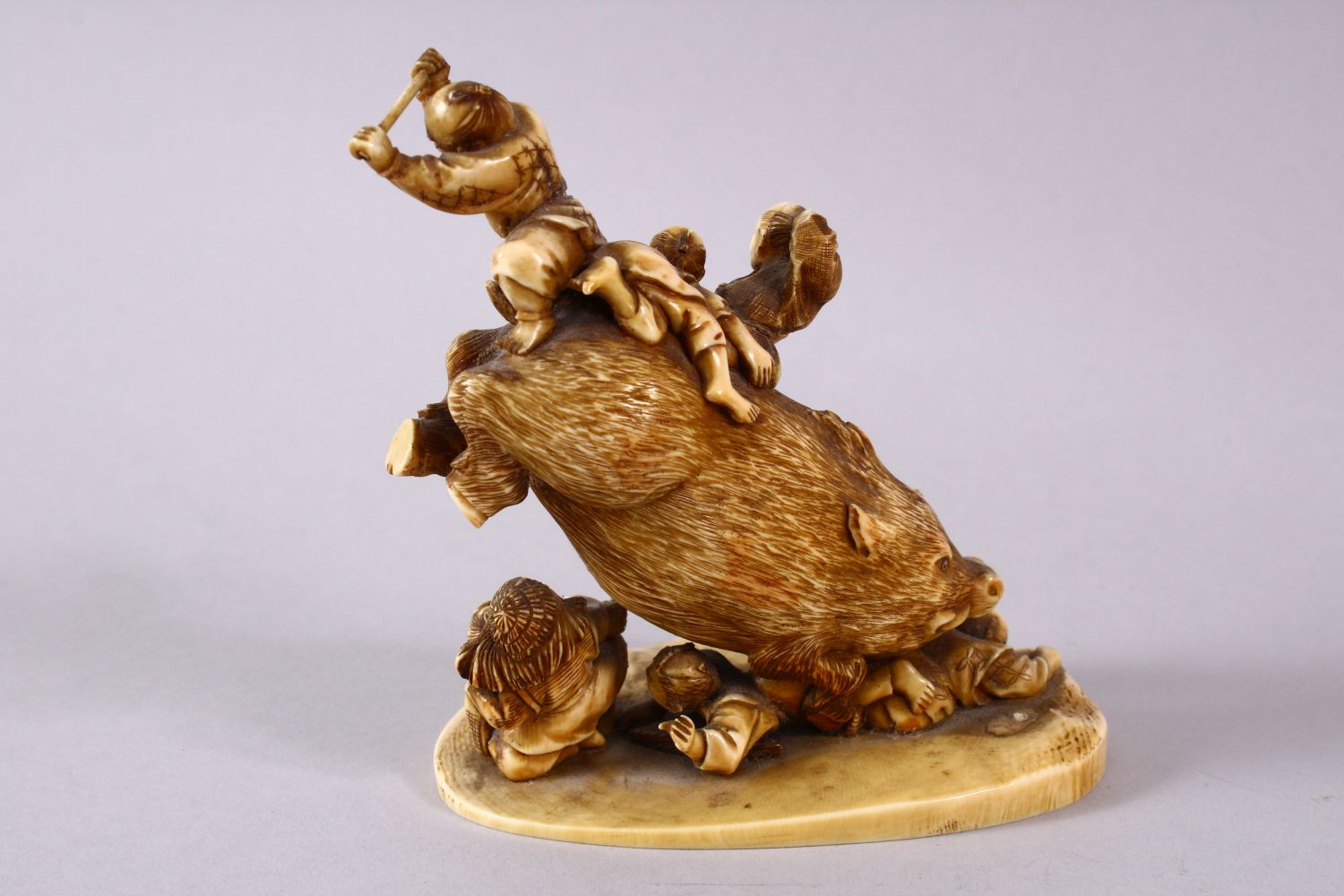 A JAPANESE MEIJI PERIOD CARVED IVORY OKIMONO GROUP- depicting a boar being attacked by numerous - Image 7 of 12
