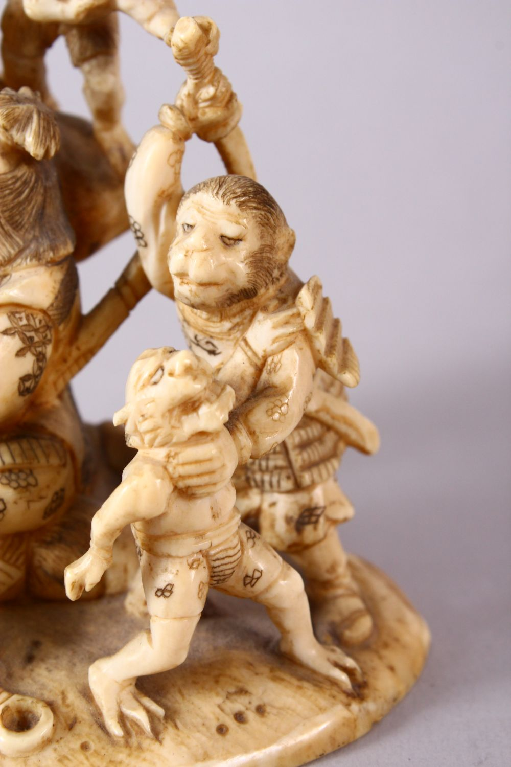 A JAPANESE MEIJI PERIOD CARVED IVORY OKIMONO GROUP - depicting figures attacking oni demons, one dog - Image 6 of 14
