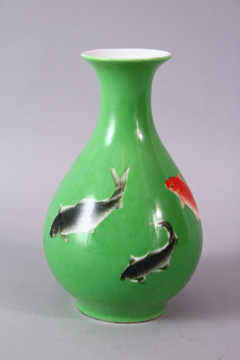 A CHINESE GREEN GLAZED VASE, painted with fish, mark in red, 15cm high. - Image 2 of 8