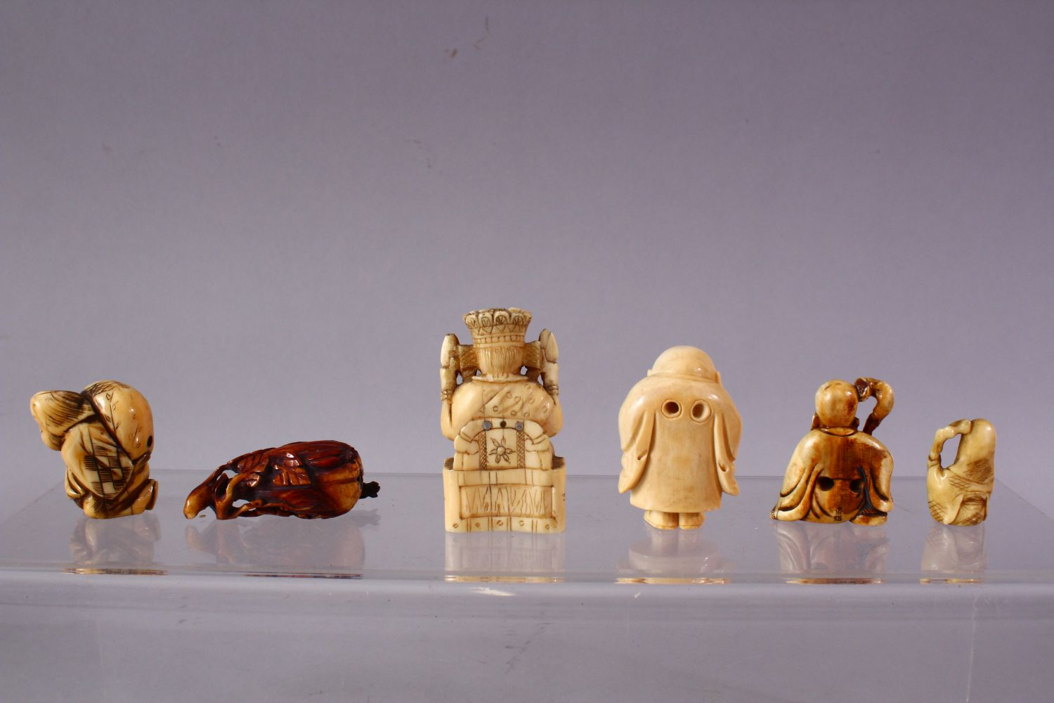A LOT OF SIX JAPANESE MEIJI PERIOD CARVED IVORY NETSUKE, one of a seated and inlaid goddess, 6cm, - Image 5 of 8