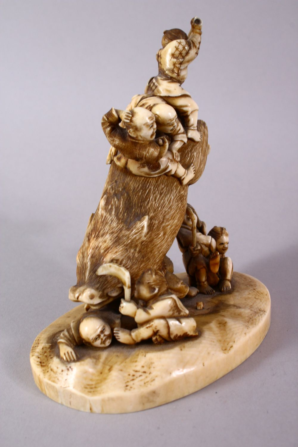 A JAPANESE MEIJI PERIOD CARVED IVORY OKIMONO GROUP- depicting a boar being attacked by numerous - Image 4 of 12