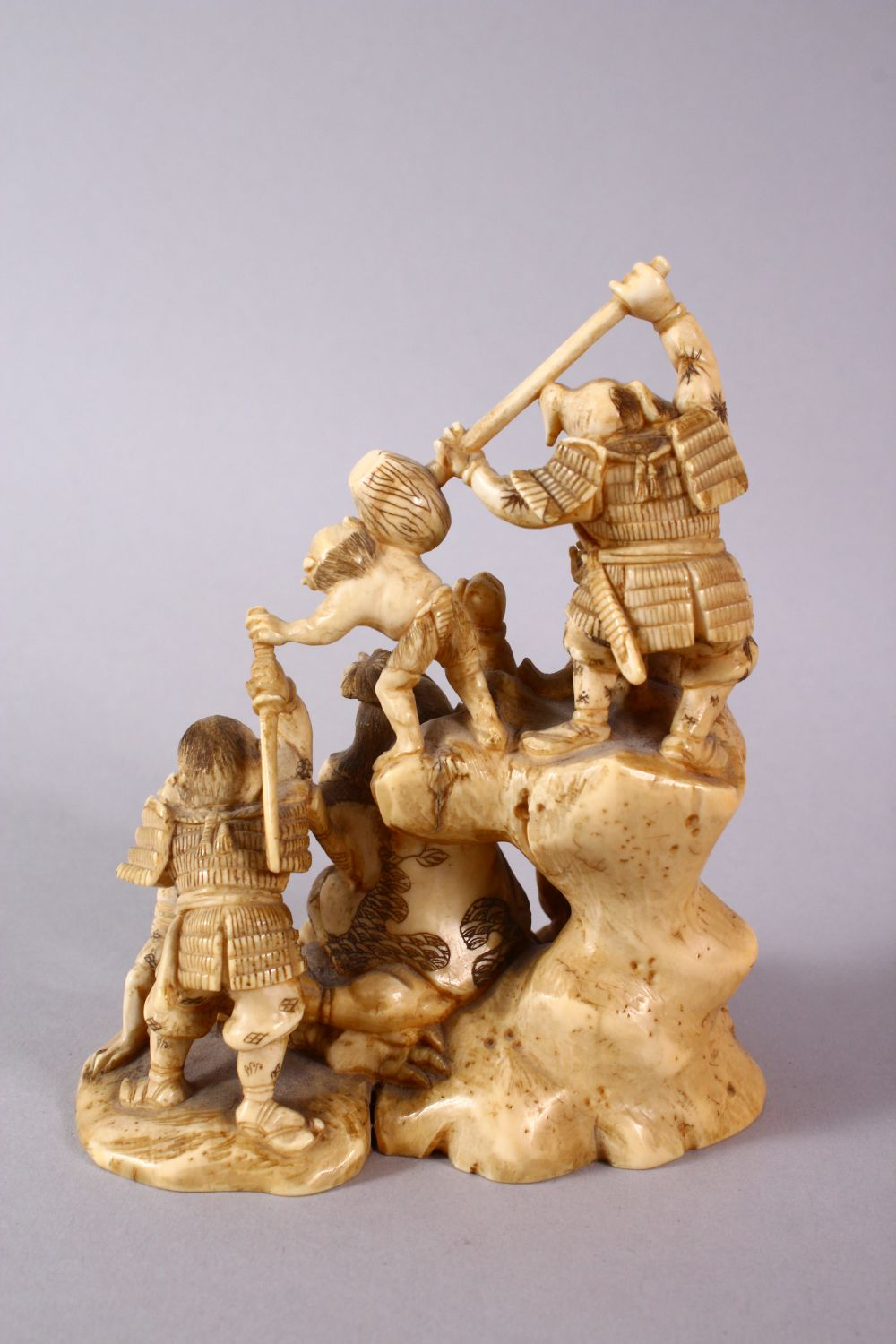 A JAPANESE MEIJI PERIOD CARVED IVORY OKIMONO GROUP - depicting figures attacking oni demons, one dog - Image 4 of 14