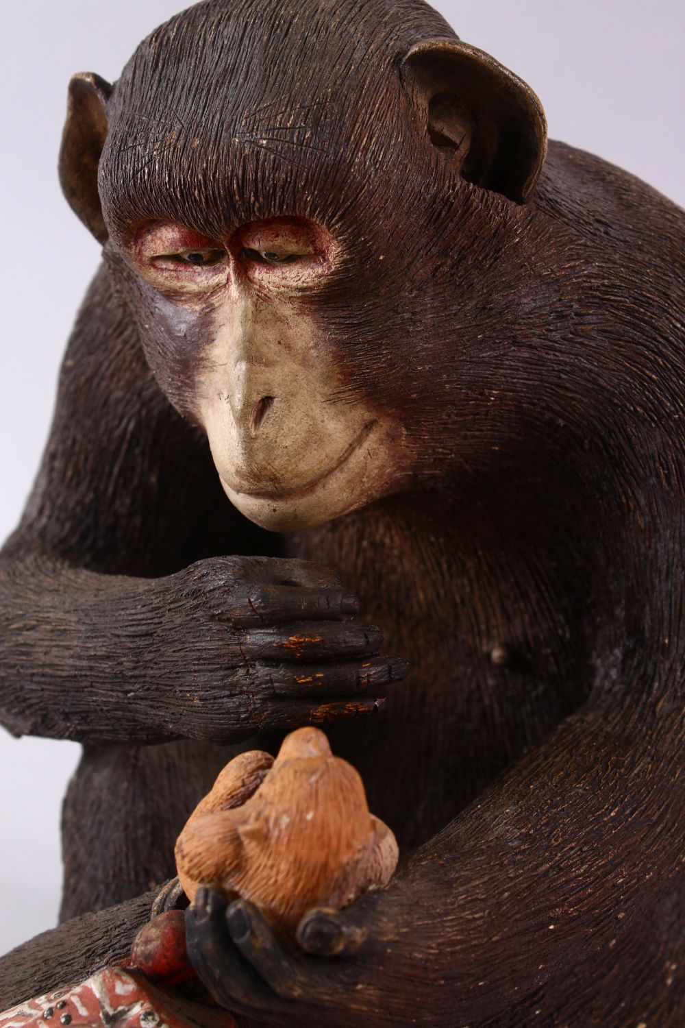 A JAPANESE POTTERY / TERRACOTTA MODEL OF A SEATED MONKEY, the monkey in a seated position holding - Image 2 of 10