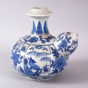 A CHINESE BLUE & WHITE PORCELAIN POURING VESSEL - FOR THE ISLAMIC MARKET, decorated with panles of