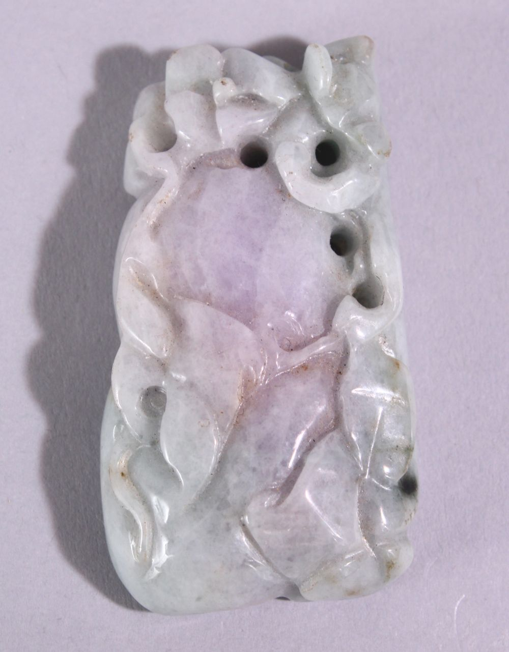 A CHINESE CARVED AND PIERCED JADITE / HARDSTONE AMULET, in the form of a guord and animal, 6cm x
