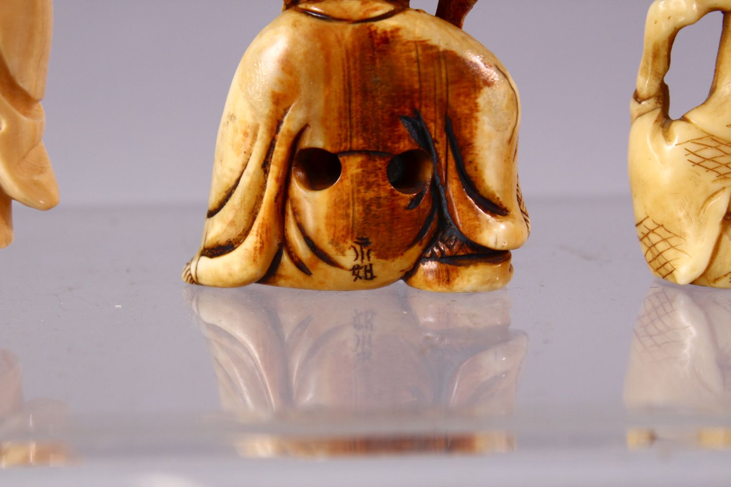 A LOT OF SIX JAPANESE MEIJI PERIOD CARVED IVORY NETSUKE, one of a seated and inlaid goddess, 6cm, - Image 6 of 8