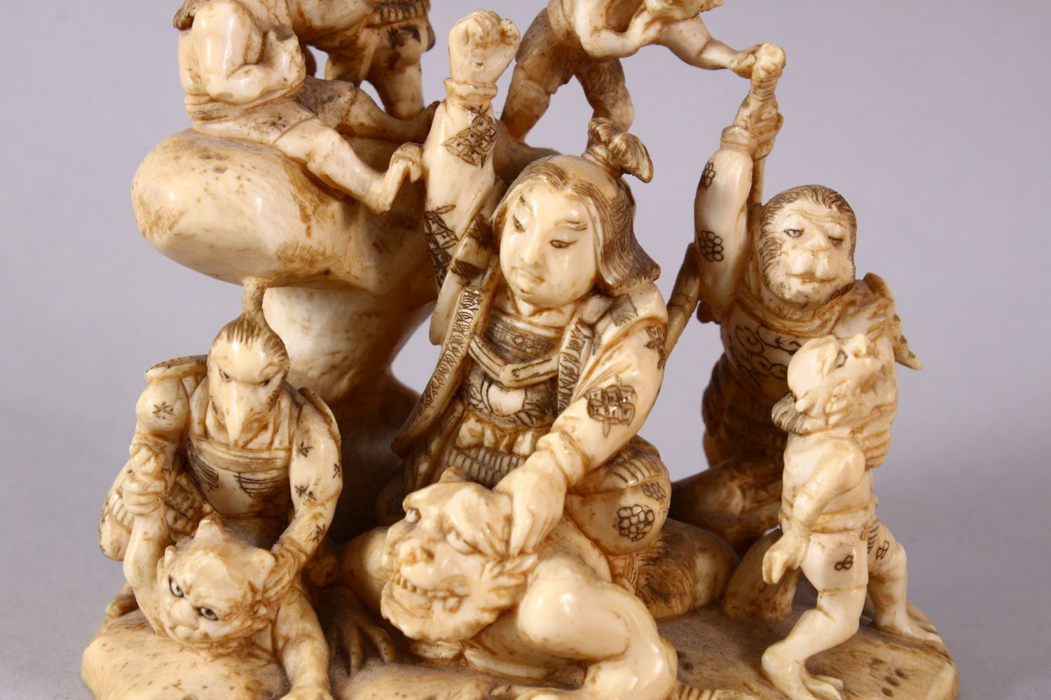 A JAPANESE MEIJI PERIOD CARVED IVORY OKIMONO GROUP - depicting figures attacking oni demons, one dog - Image 2 of 14