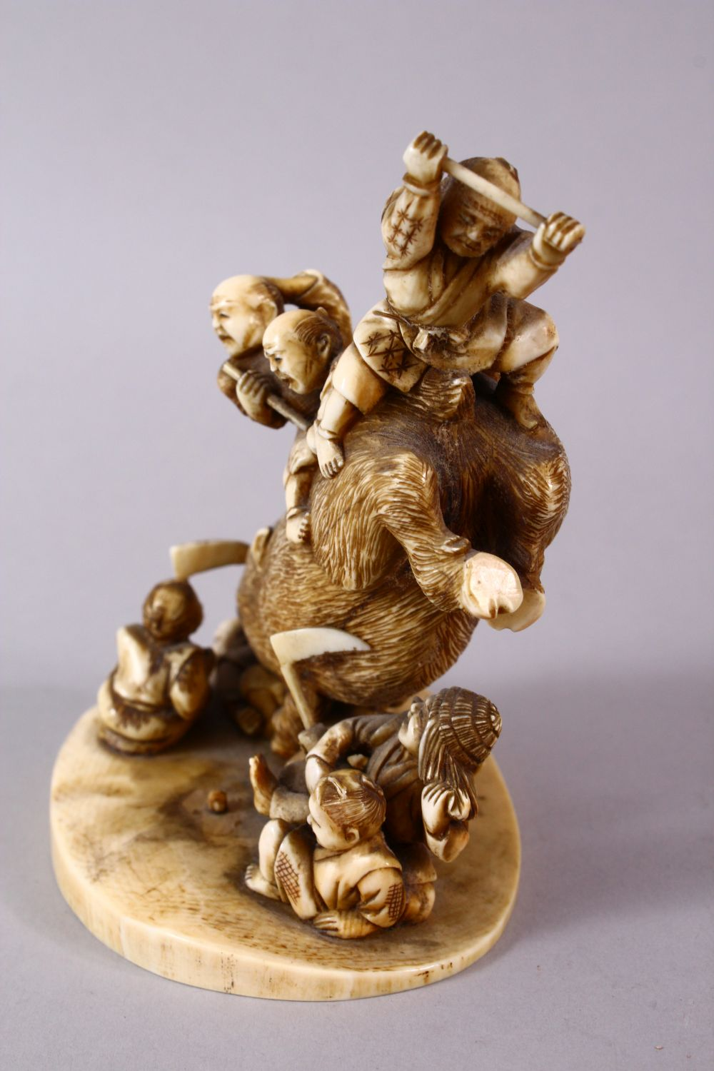 A JAPANESE MEIJI PERIOD CARVED IVORY OKIMONO GROUP- depicting a boar being attacked by numerous - Image 8 of 12