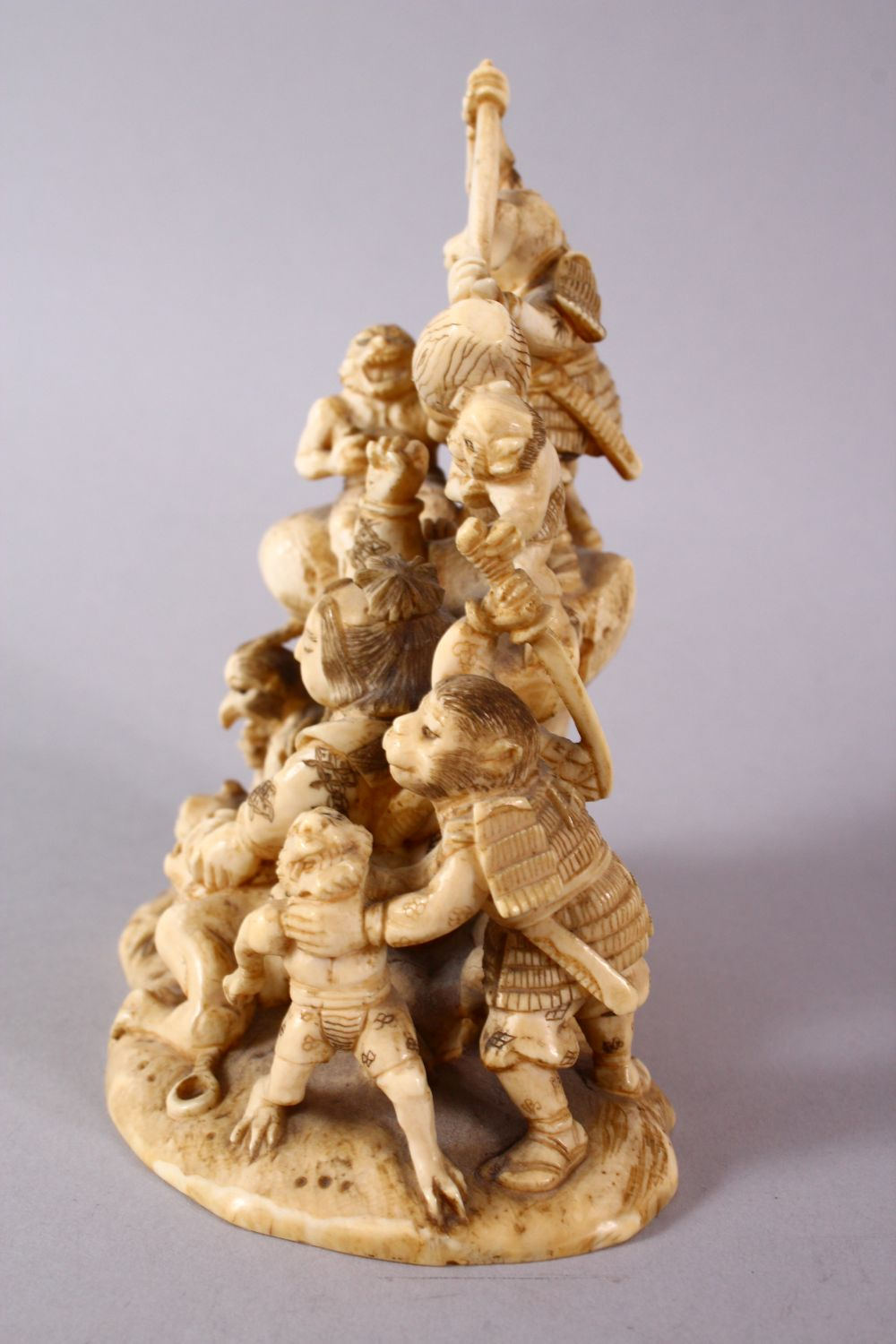 A JAPANESE MEIJI PERIOD CARVED IVORY OKIMONO GROUP - depicting figures attacking oni demons, one dog - Image 5 of 14