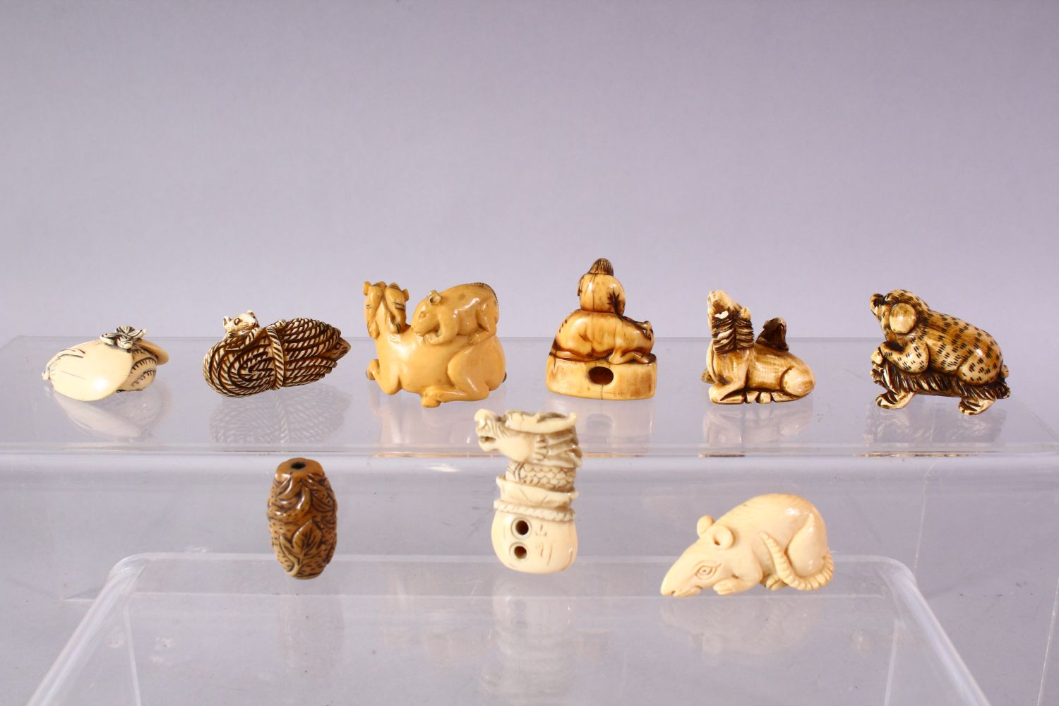 A LOT OF EIGHT JAPANESE MEIJI / EDO PERIOD CARVED IVORY NETSUKE & OJIME, one possibly later edo - Image 7 of 11