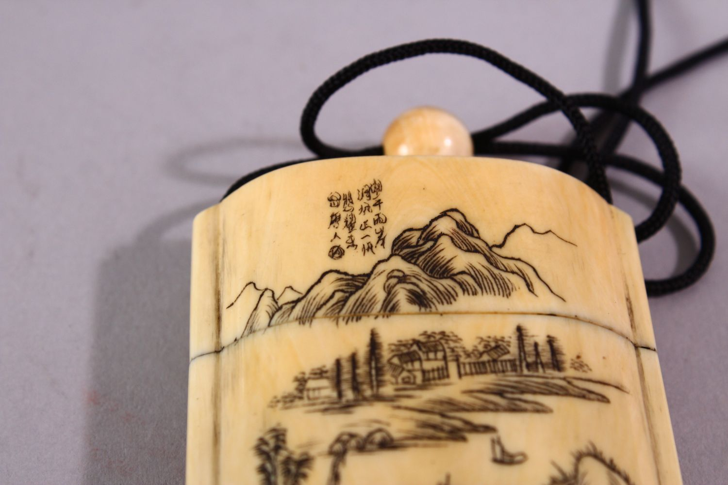 A JAPANESE MEIJI PERIOD CARVED IVORY THREE CASE INRO & NETSUKE, The inro carved with native - Image 4 of 7