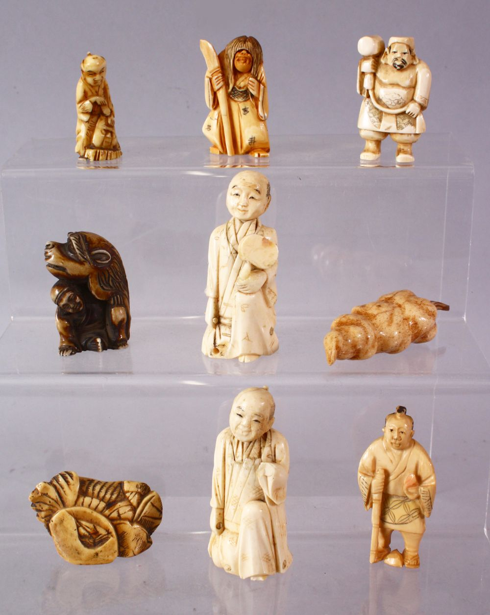 A LOT OF NINE JAPANESE MEIJI PERIOD CARVED IVORY / ANTLER NETSUKE - A stag antler carved as a