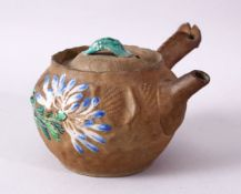 A JAPANESE BANKO STYLE POTTERY ENAMEL TEAPOT, with floral enamel decoration, 15cm.