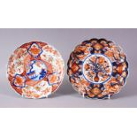 TWO MEIJI PERIOD IMARI PLATES, 20cm and 22cm.