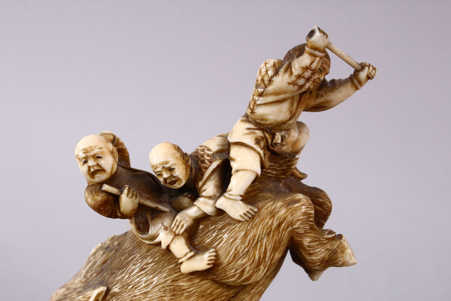 A JAPANESE MEIJI PERIOD CARVED IVORY OKIMONO GROUP- depicting a boar being attacked by numerous - Image 2 of 12