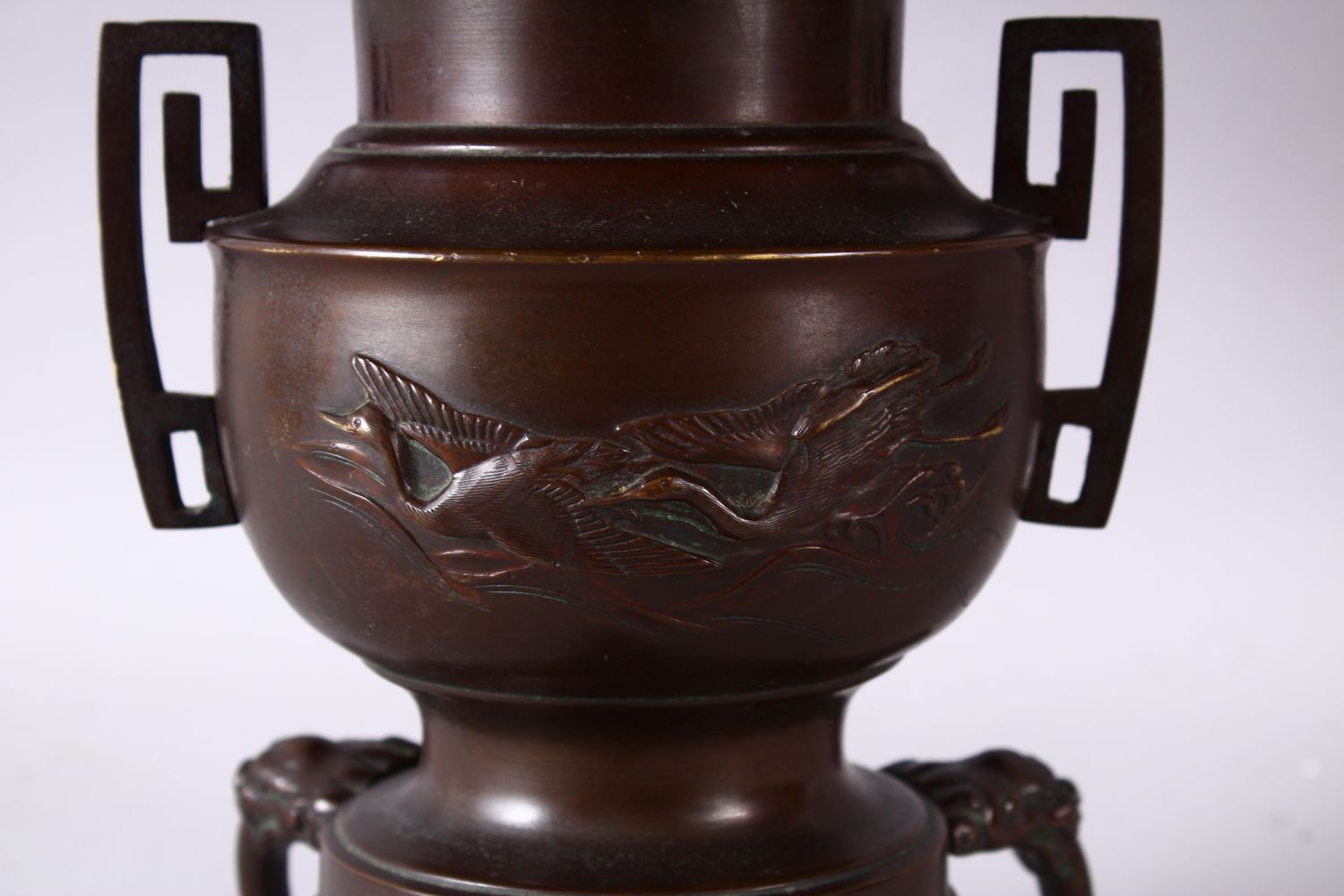 A 19TH CENTURY JAPANESE BRONZE TWO HANDLED VASE on three curving legs, with large circular top - Image 2 of 6