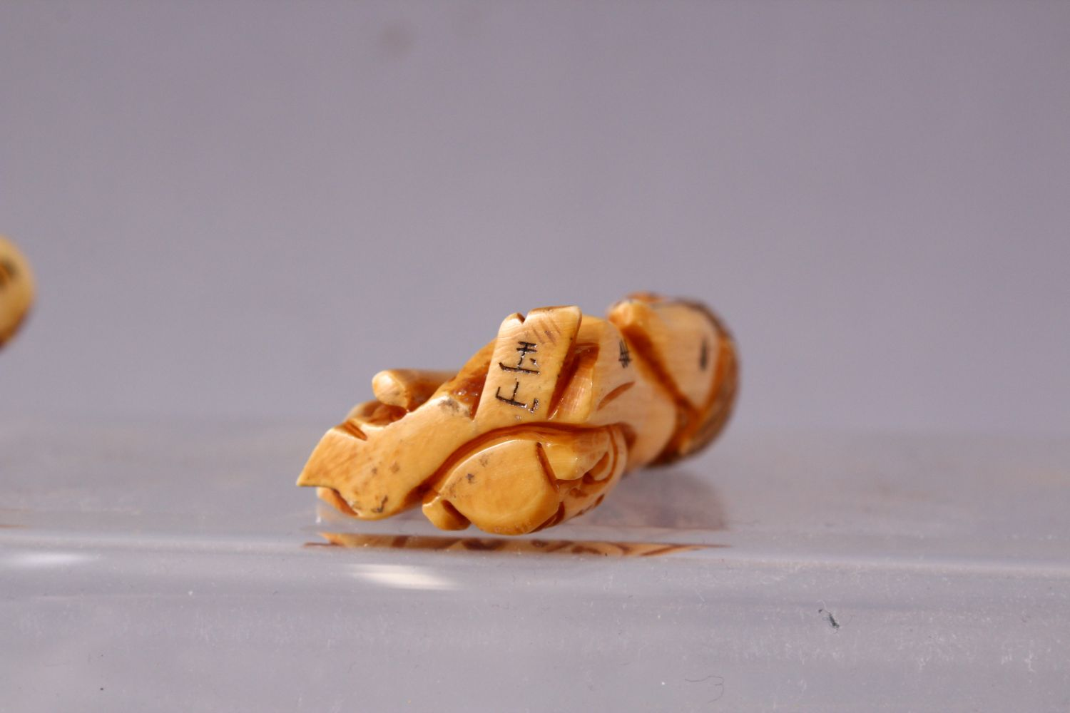 A LOT OF NINE JAPANESE MEIJI PERIOD CARVED IVORY / ANTLER NETSUKE - A stag antler carved as a - Image 7 of 8