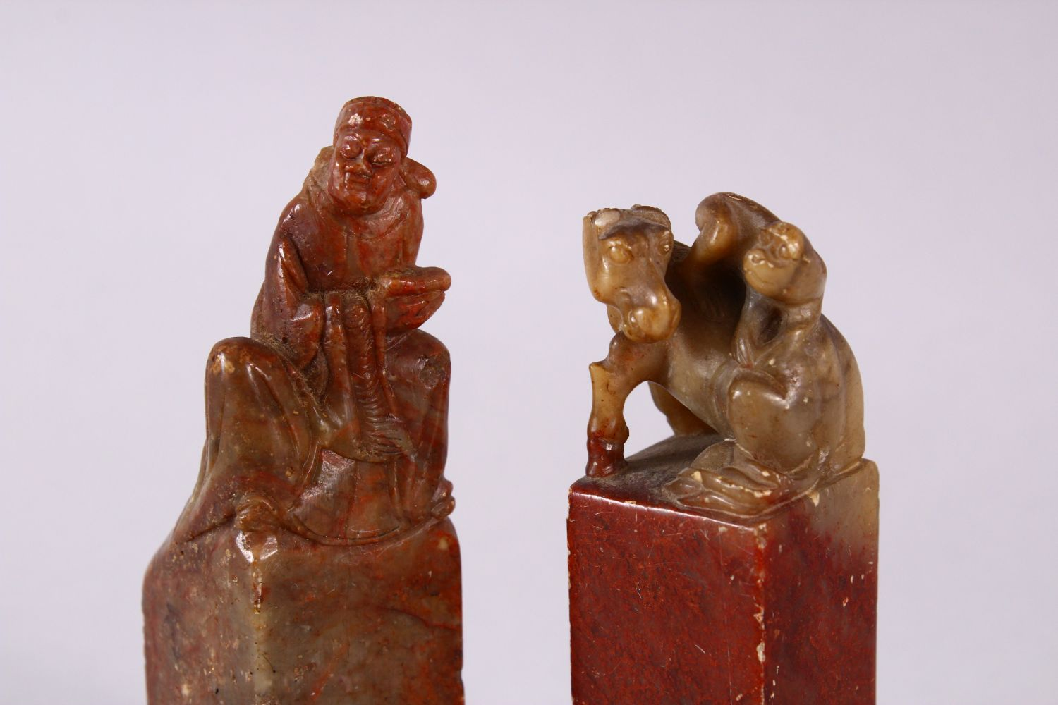 A PAIR OF 19TH / 20TH CENTURY CHINESE CARVED SOAPSTONE SEALS, one of monkeys upon horse, the other - Image 2 of 4