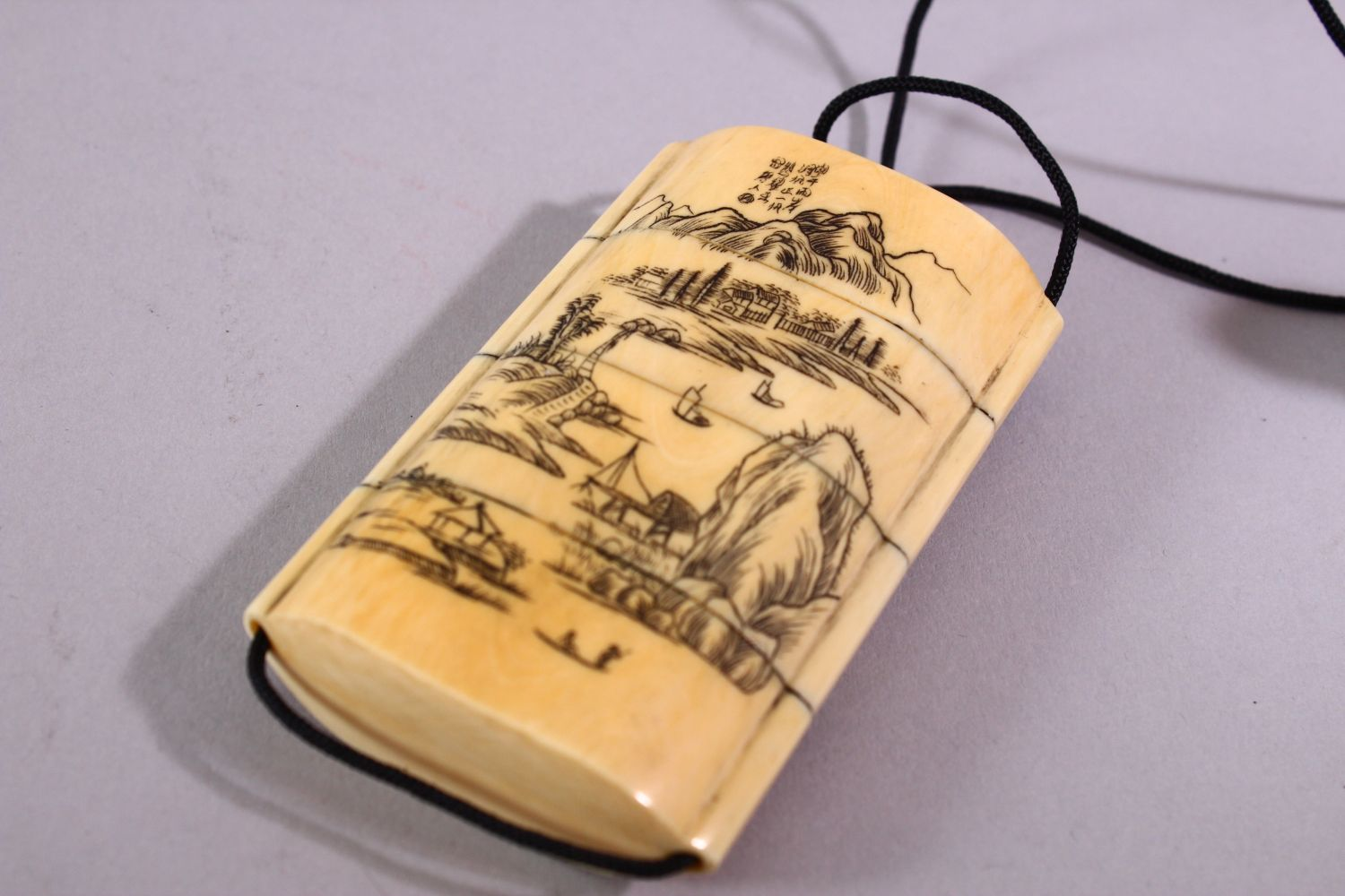 A JAPANESE MEIJI PERIOD CARVED IVORY THREE CASE INRO & NETSUKE, The inro carved with native - Image 3 of 7