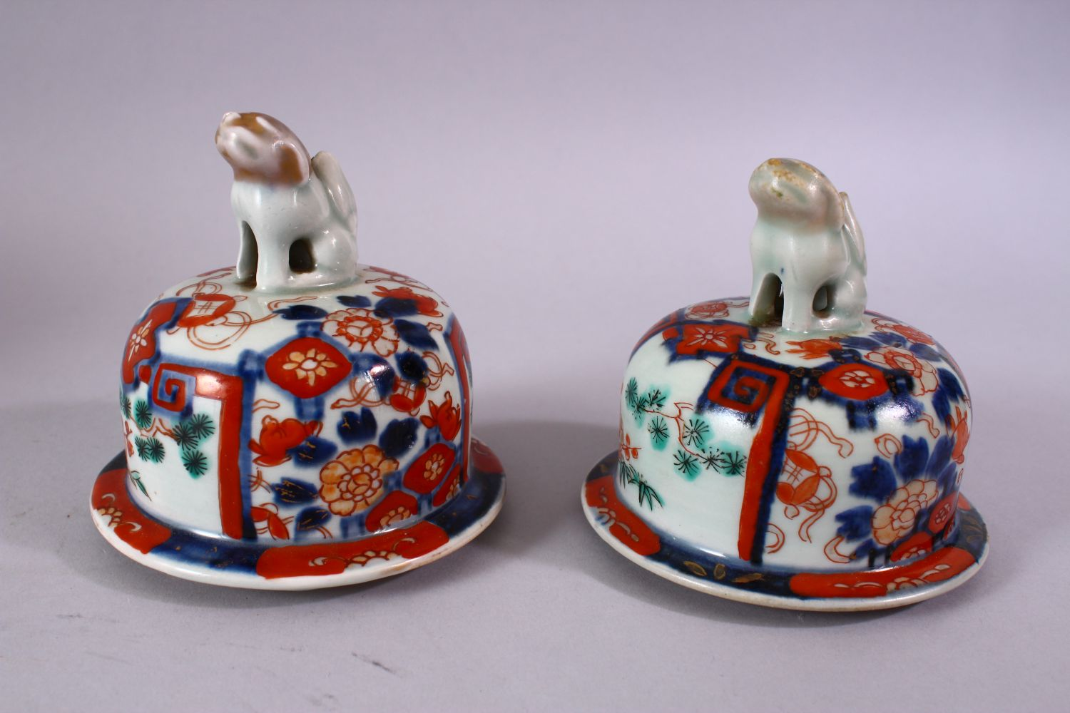A PAIR OF MEIJI PERIOD IMARI VASES AND COVERS, with kylin finials, overall 30cm high. - Image 9 of 10