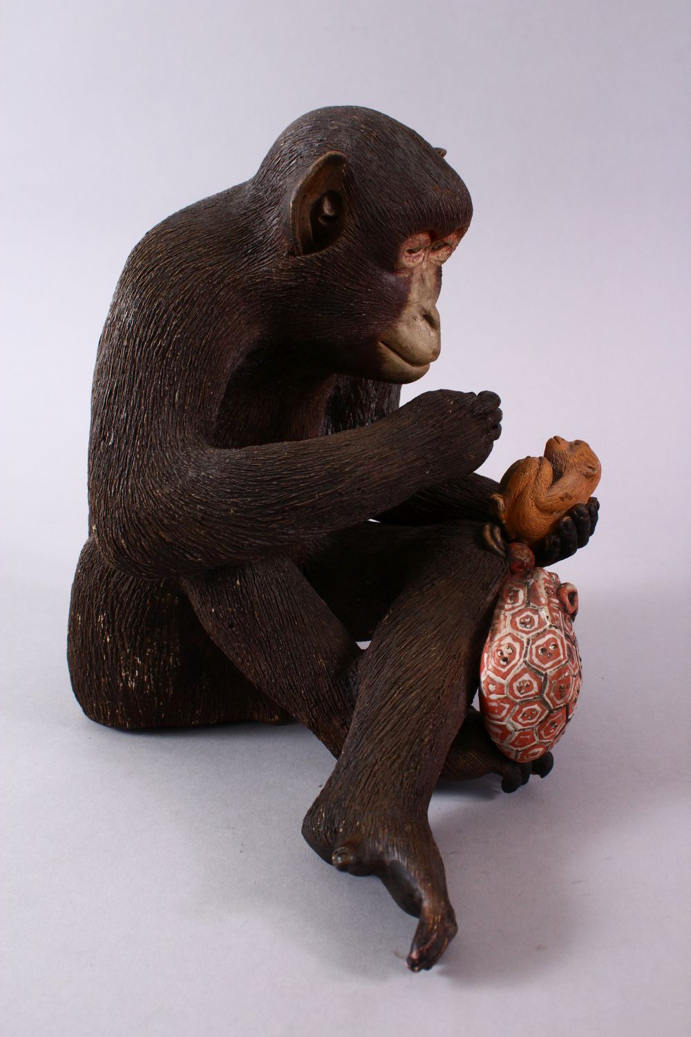 A JAPANESE POTTERY / TERRACOTTA MODEL OF A SEATED MONKEY, the monkey in a seated position holding - Image 3 of 10